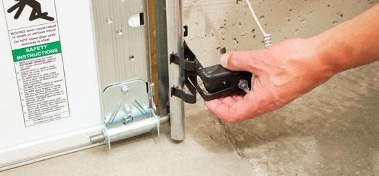 Everything doors more llc racine wisconsin for Fix garage door sensor